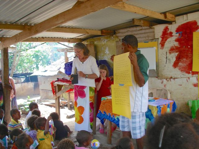 58-jeff-and-anne-donated-bibles-in-bislama-and-english-to-the-tagabe-village-willie-stood-by-to-translate-what-i-said-into-bislama-young-laura-helped-distribute-prizes-to-the-children