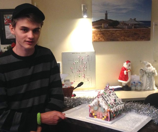 133.1. Josh and the gingerbread house he kindly made to give to residents of the elder care center on Phillip Island, Australia
