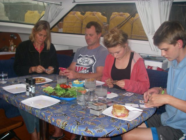 15. Powerful concentration was required by Beatrice, Kenny, Gabriella and Josh as they tried to solve a challenging card game at dinnertime on Joyful
