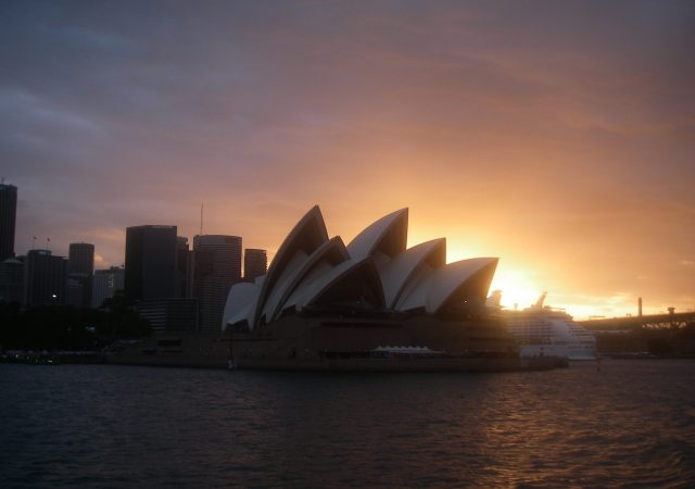 99.1. I took this photo of the Sydney Opera House sillouetted against the setting sun as seen from the ferry boat as we left Sydney one evening. JPG