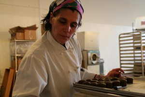 Cristina Bresher inspects chocolates
