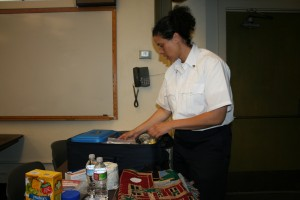 NERT Trainer Erika Arteseros pulls out her personal emergency kit