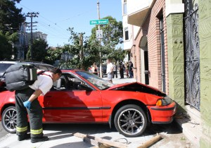 A red 1990 Acura crashes into a home on South Van Ness.