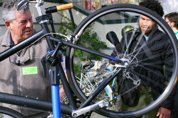 Larry Kline, owner of Noe Valley Cyclery, helps a commuter adjust a derailleur at Harrison and Caesar Chavez. When he opened the shop over 30 years ago, he says, there weren't even mountain bikes yet.