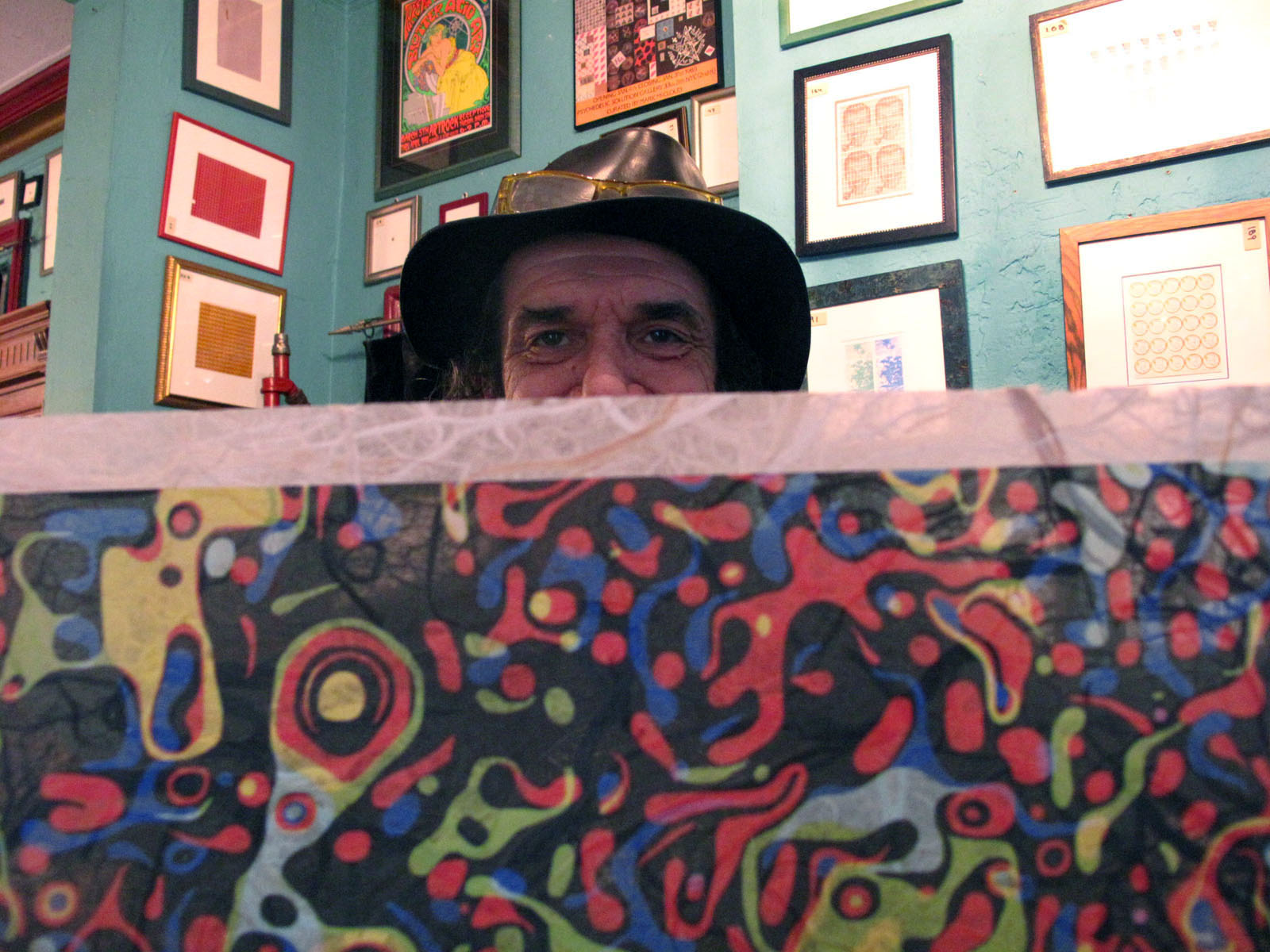 """Mark McCloud revels in psychedelic visuals inside his Mission home, which he dubbs the """"Institute of Illegal Images,"""" a reference to his archive of LSD-inspired art."""