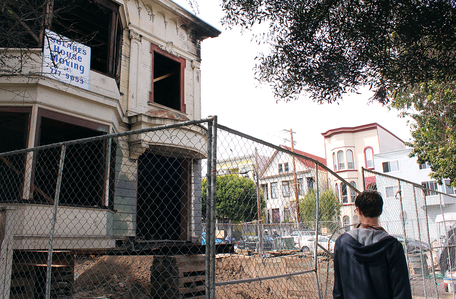 A man looks at the ruined old parsonage.