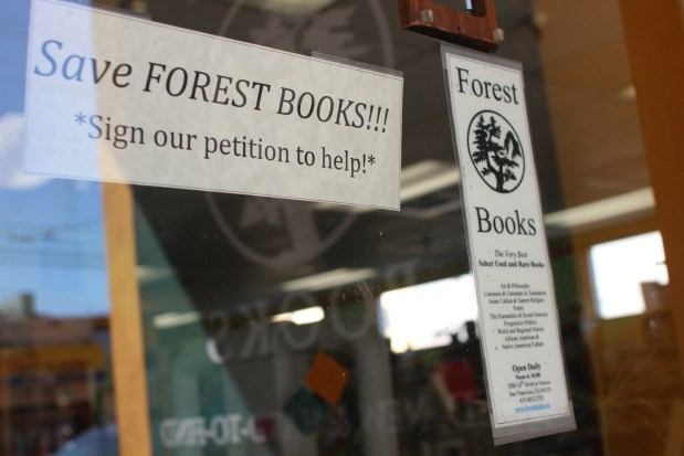 signs on the door at Forest Books