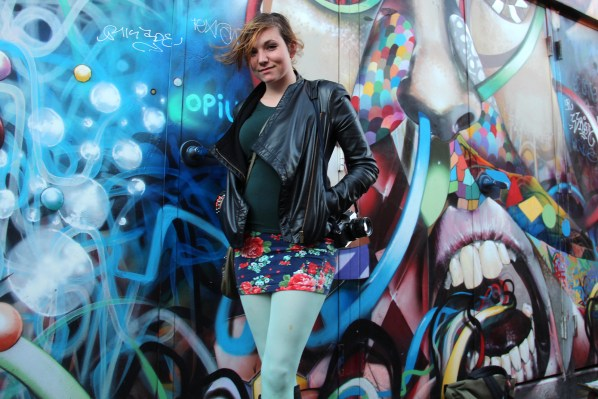 Nichole Albright keeps it cool in mint green tights, a floral skirt and a structured leather jacket.