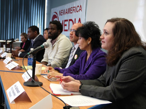 Amy Bacharach, far right, listens to a question from a member of the audience. Eight of ten candidates vying for four seats on the City College of San Francisco Board of Trustees took questions during a panel debate on Friday at the New America Media office.