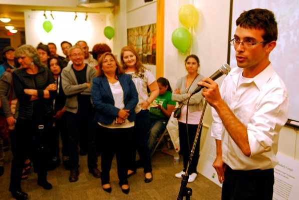 Emiliano Bourgois-Chacon, the director of the San Francisco Day Labor Program and Women's Collective, speaks during the ceremony marking his program's collaboration with the Dolores Street Community Services.