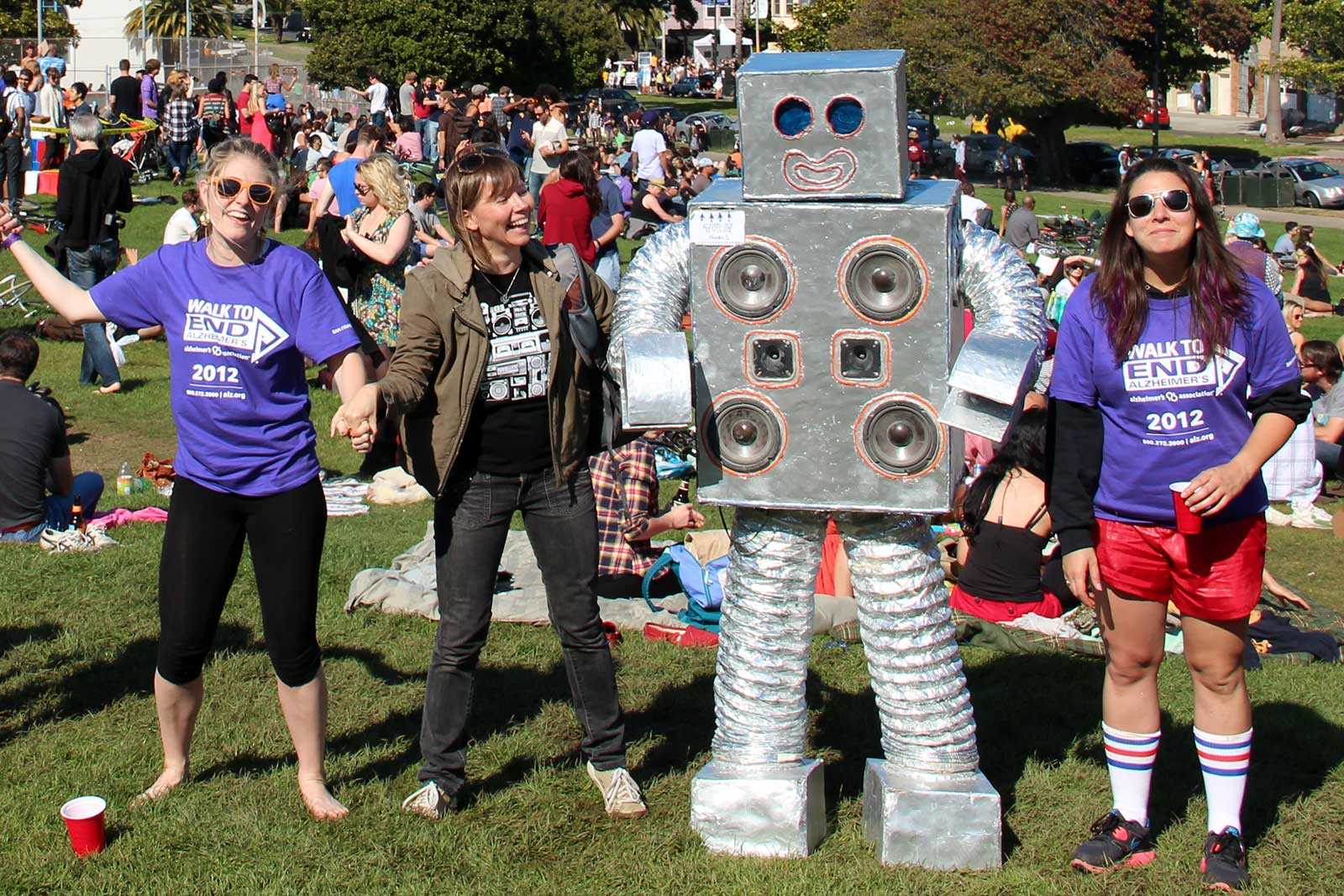 Robot dances in Dolores Park with tech savvy scavenger hunt participants.