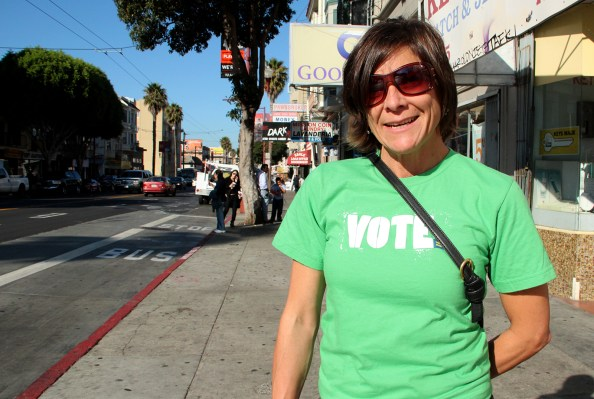 This voter on Mission Street filed by mail, but is showing her support today.