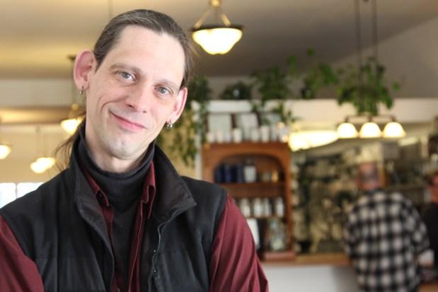 Alan Beatts, owner of Borderlands Books and neighboring Borderlands Cafe. Photo by Yousur Alhlou.