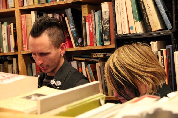 Friends browse through books at Adobe Bookshop after readings by Rebecca Solnit, Stephen Elliott and Michelle Tea. photo by Molly Oleson