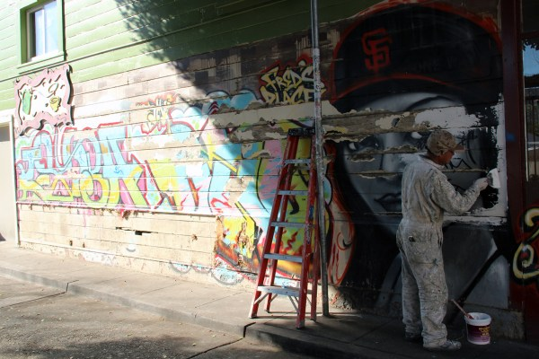 A mural at 24th and Osage streets was being painted over today.