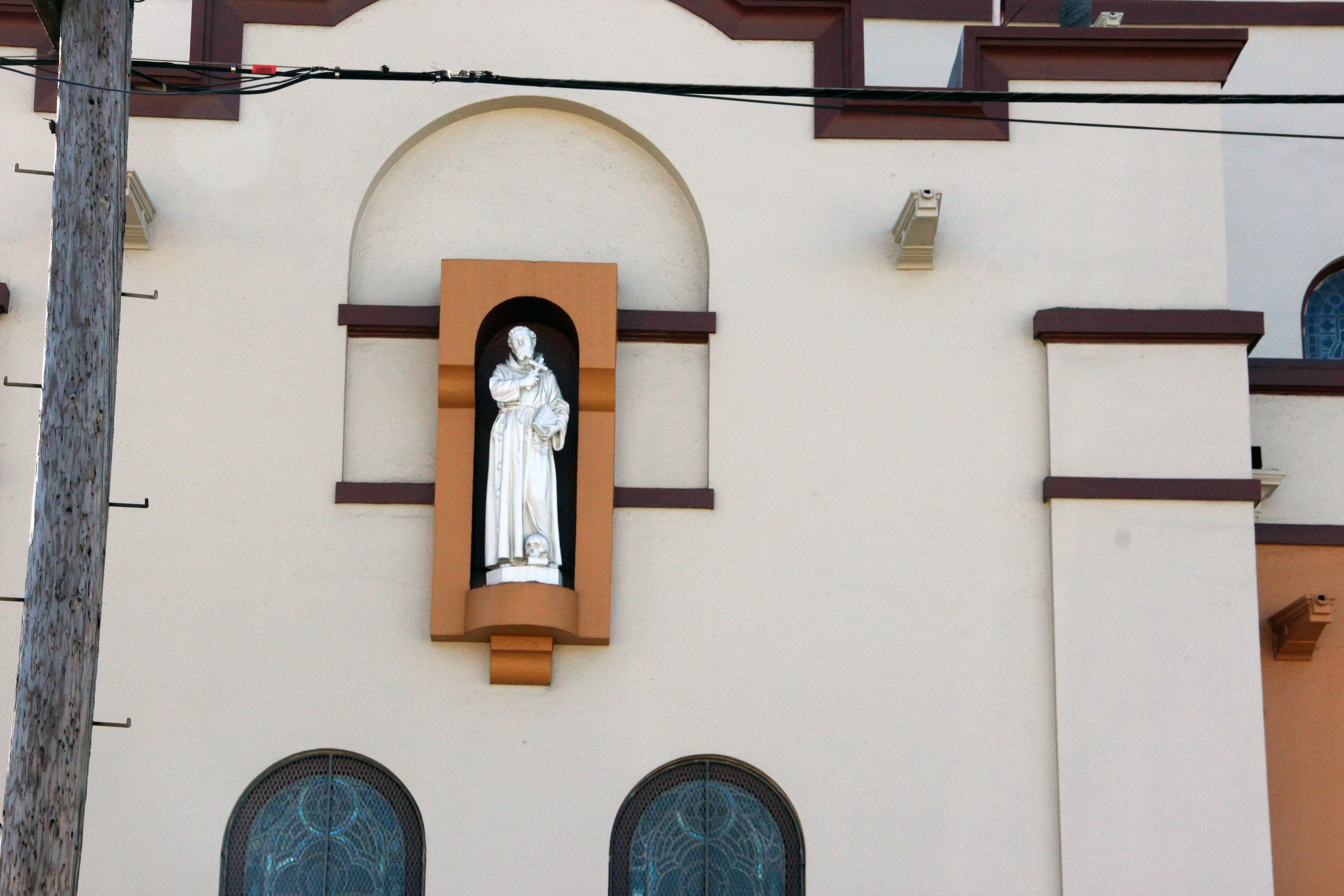 A saint overlooks 18th and South Van Ness
