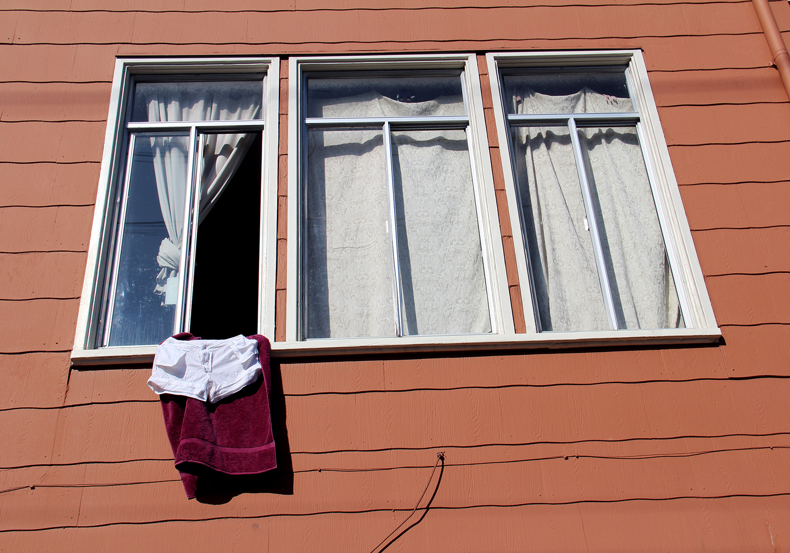 A pair of shorts dries on a windowsill on a warm day in the Mission. Photo by Molly Oleson