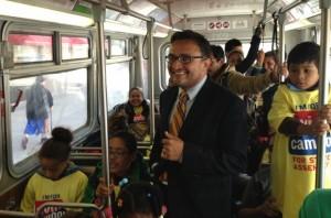 District 9 Supervisor David Campos rides the 49 Mission/Van Ness bus to City Hall Thursday with more than a dozen children. Photo by Chris Sanchez.