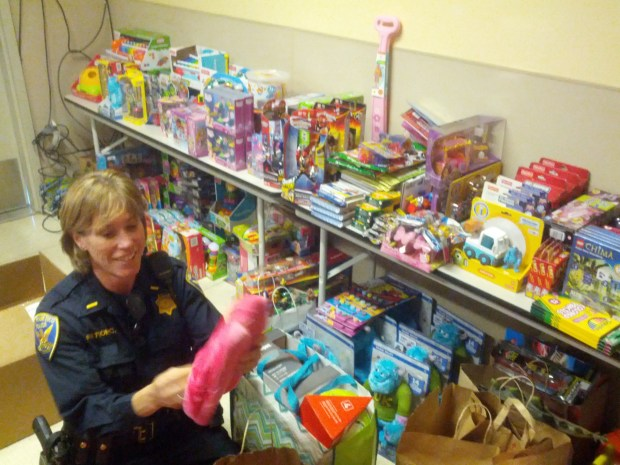 The SFPD sorting toys for today's event.
