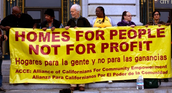 Housing advocates protest evictions outside City Hall. Photo by Andy Mannix.