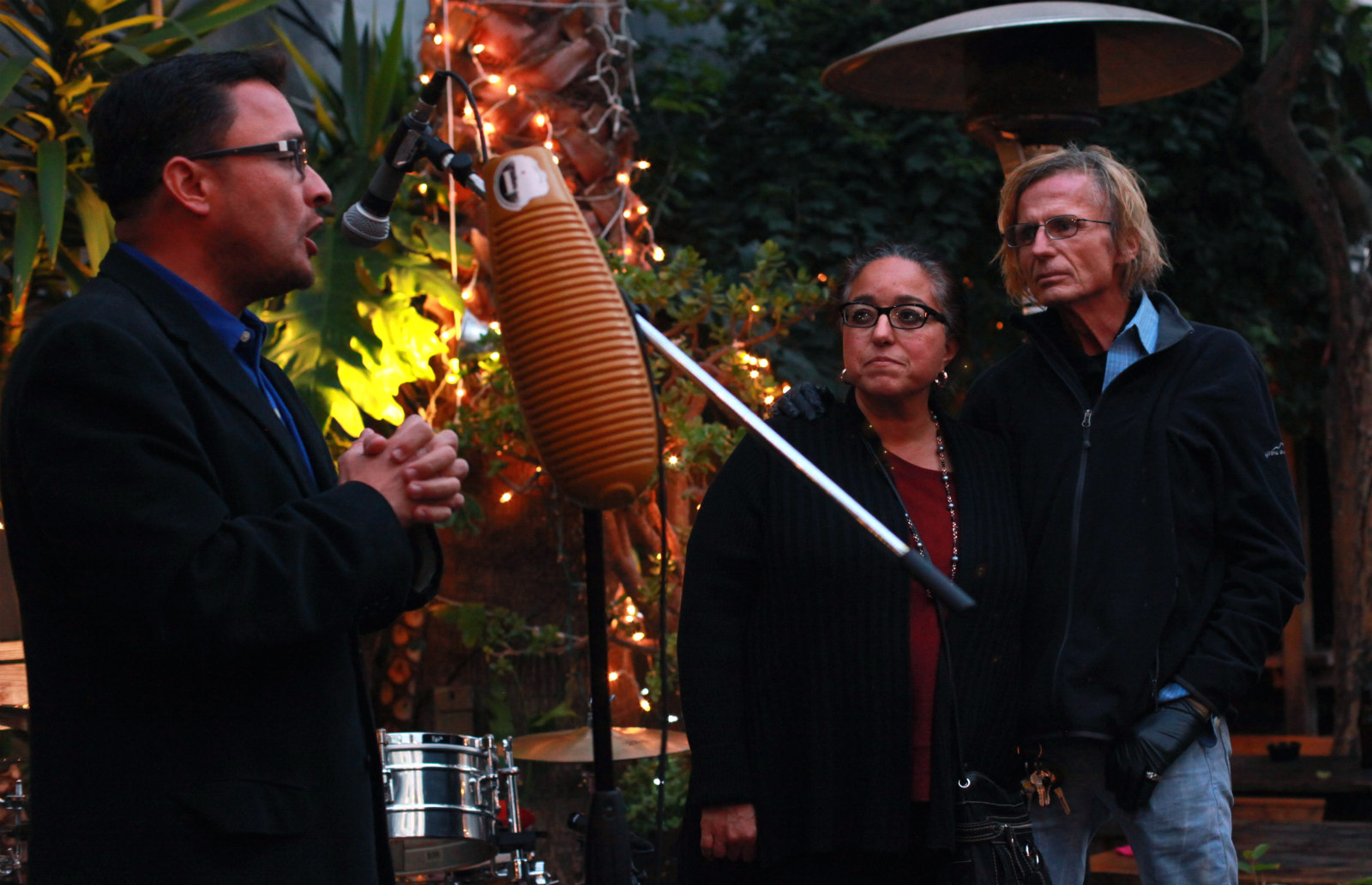 Supervisor David Campos (left) speaks at a benefit for Christina Olague (center) who stands with her housemate Patrick Ferry.