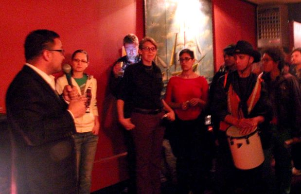 Supervisor David Campos (left) speaks to the Tech Works Against Displacement Happy Hour.  Photo by Rigoberto Hernandez.
