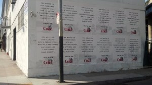 """A wall plastered with """"You're On"""" Diet Coke ads on Stevenson Street."""