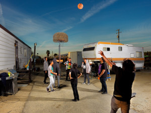 Sam Comen, Basketball at dusk in Lost Hills, CA. March 7, 2011. Photo courtesy of the San Francisco Arts Commission.