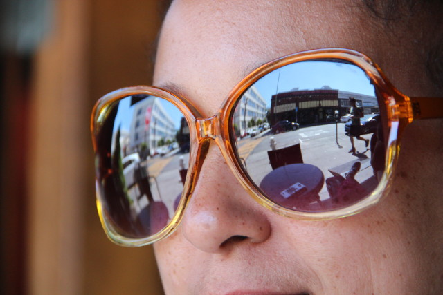A fashionista gazes out onto 22nd Street while relaxing at The Revolution Cafe near Mission Street. Photo by Leslie Nguyen-Okwu.