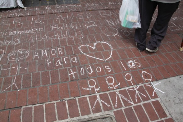 """""""Love for all the children."""" The chalk memorial also served as the ending place for the protest against the deportation of children at our border, and shared a sentiment of protecting children from violence. Photo by Joe Rivano Barros."""