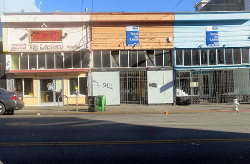 The vacant storefront in the middle could have been a Jack Spade.  Next door, Idol Vintage recently moved out.  Photo by Lydia Chávez