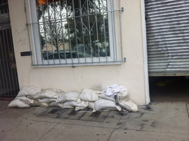 On Folsom and 17th, businesses prepare with sandbags.