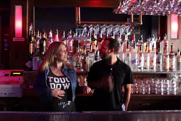 "Bar proprietor Nicole DeWald, a.k.a ""Blondie,"" chats with bartender James Martin. Photo by Laura Wenus"