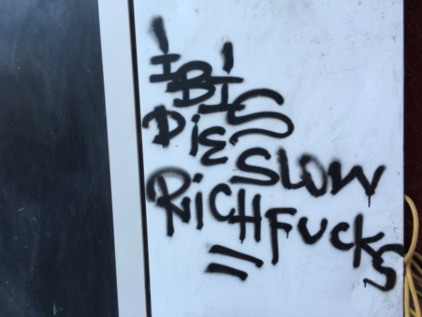 Black graffiti was scrawled on the Mission Street side sometime between Tuesday and Wednesday. Photo by Joe Rivano Barros.