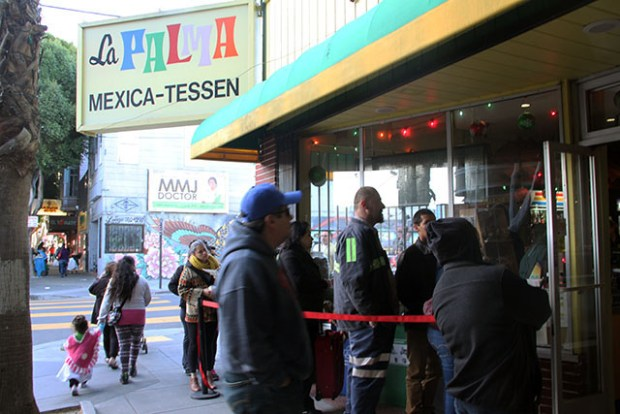 A line of patrons waiting to buy masa forming outside of La Palma at 2884 on 24th St. Photo By Laura Waxmann