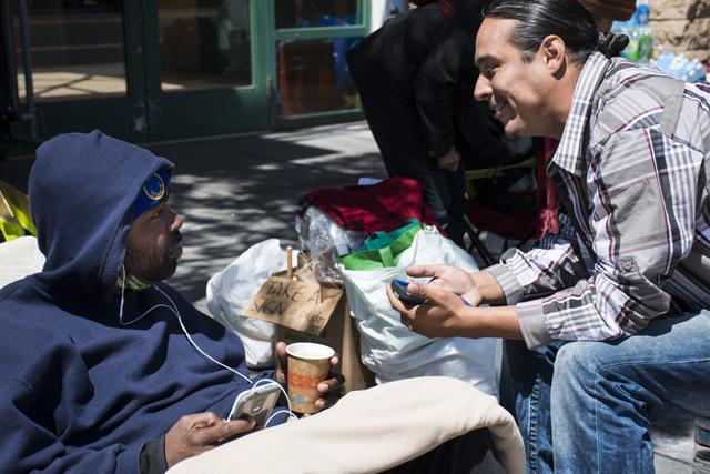 Ike Pinkston sitting outside Mission Station on Wednesday. Photo by Lola M. Chavez