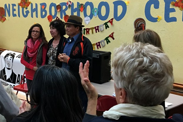 Supporters applaud Elvira and Refugio Nieto at a meeting to discuss a memorial for their son. Photo by Laura Wenus