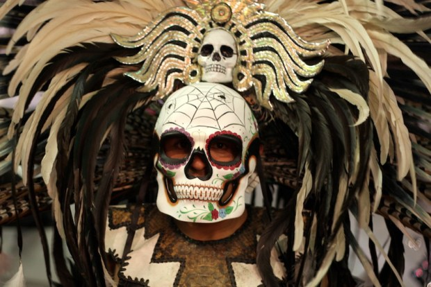 Juan Serrano, member of Mixcoatl Anahuac, an Aztec dance group, after a performance at the Mission Cultural Center Thursday night for Dia de los Muertos.