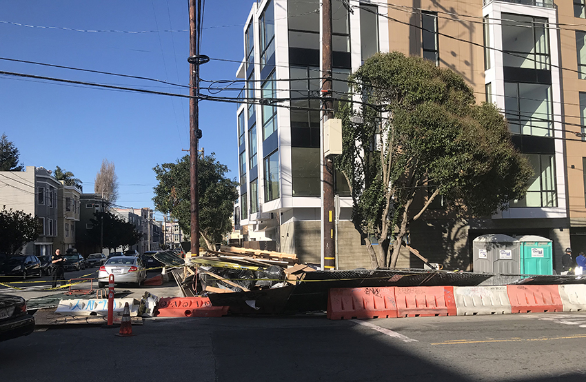 A wind topples a construction fence on 23rd and San Jose