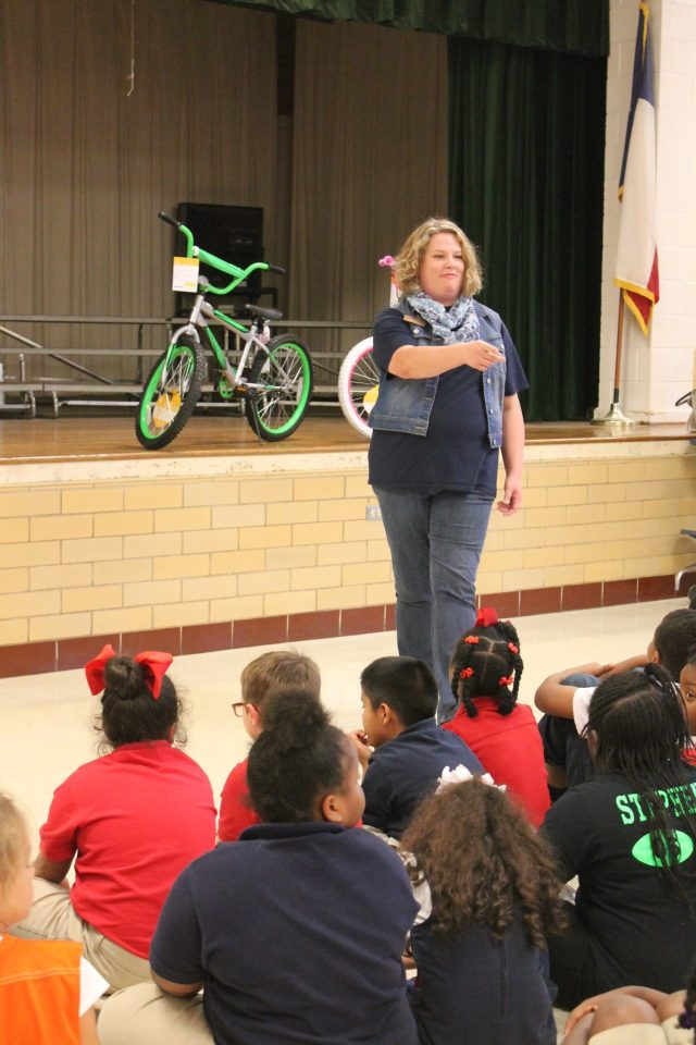 Misty Scott Director of Mission Marshall Announcing Read to Ride to Marshall ISD Third Graders Oct 2016