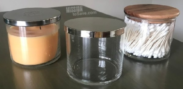 candle, empty candle jar and repurposed jar