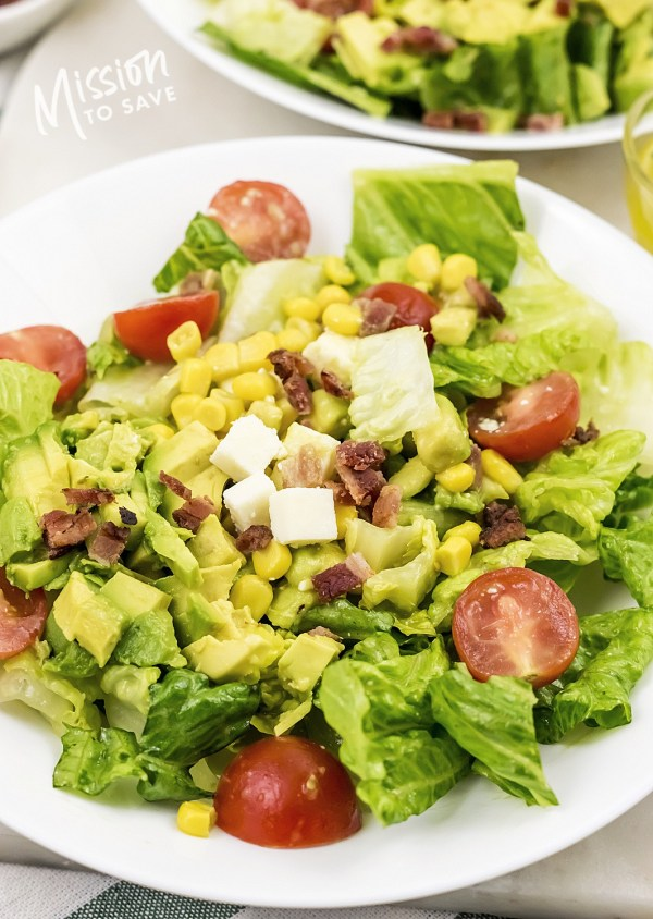 close up of cobb salad with avocado bacon corn