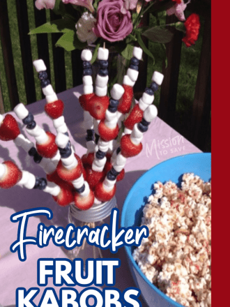 patriotic firecracker fruit kabobs on a party food table