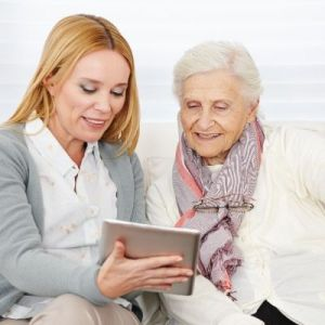 Advisor helping a client on a tablet