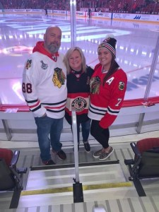 Irene, her husband, and daughter at a Chicago Blackhawks game