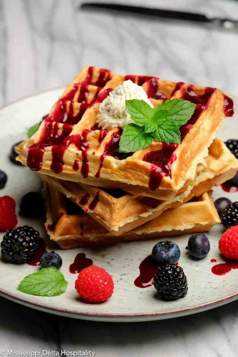Belgian Waffles With Fruit Puree and Whipped Cream