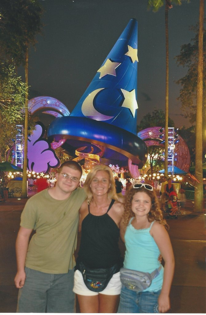 Ian (15), Traci, and Caylie (11) in front of the Sorcerer's Hat