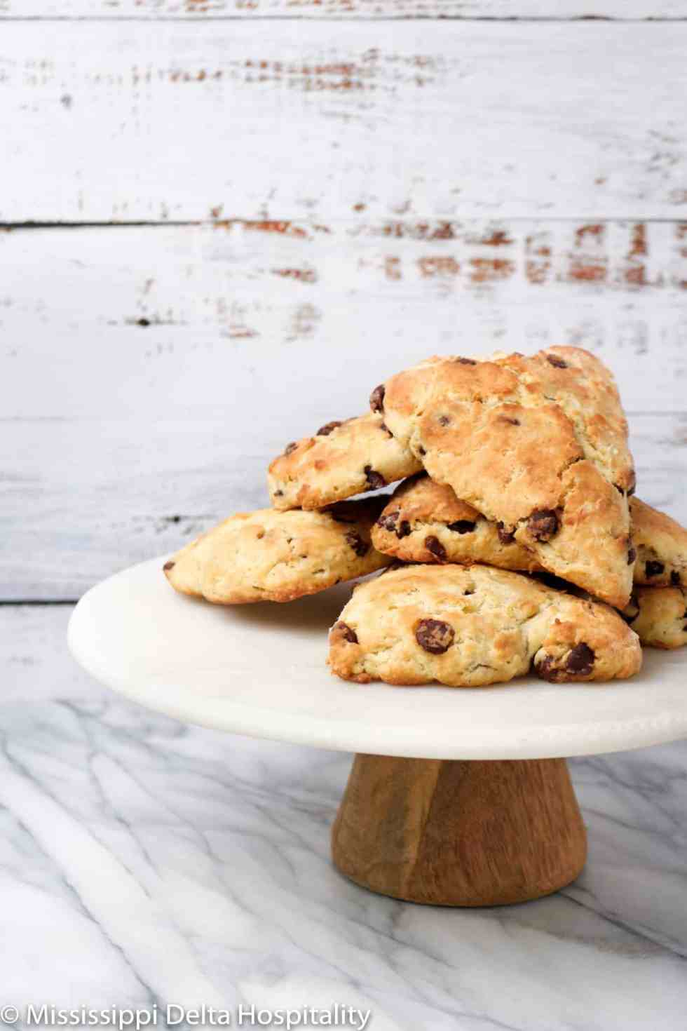 chocolate chip scones on a marble cake plate.
