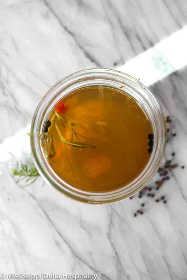 turkey brine in a glass jar on a marble board