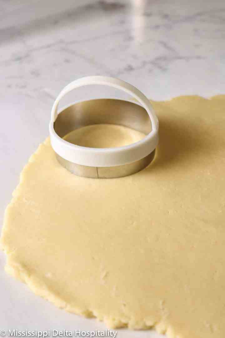 cookie cutter set on the cookie dough